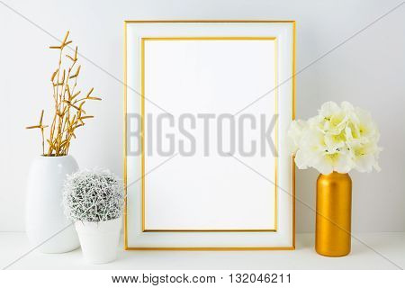 White frame mockup with small cactus. Frame mockup. Poster Mockup. Styled mockup. Product mockup. Design Mockup. White frame mockup. Gold frame mockup.