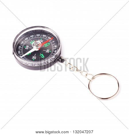 Black small compass over isolated white background