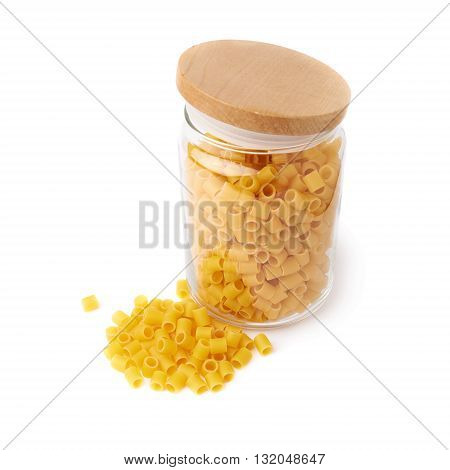 Glass jar filled with dry ditalini yellow pasta over isolated white background