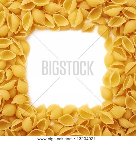 Square frame made of dry conchiglie yellow pasta over isolated white background