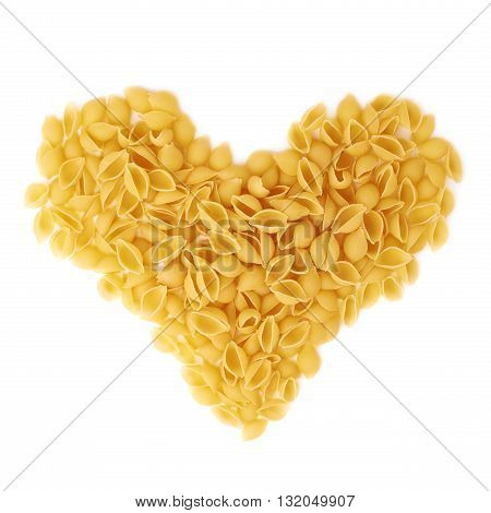 Heart shape made of dry conchiglie yellow pasta over isolated white background
