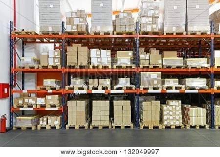 Crates and Boxes at Shelving System in Warehouse
