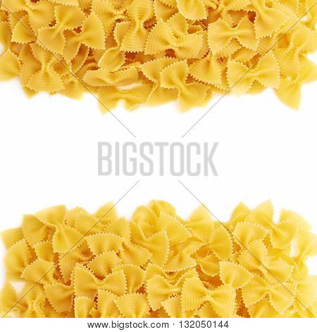 Pile of dry farfalle yellow pasta over isolated white background