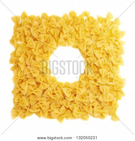 Round frame made of dry farfalle yellow pasta over isolated white background