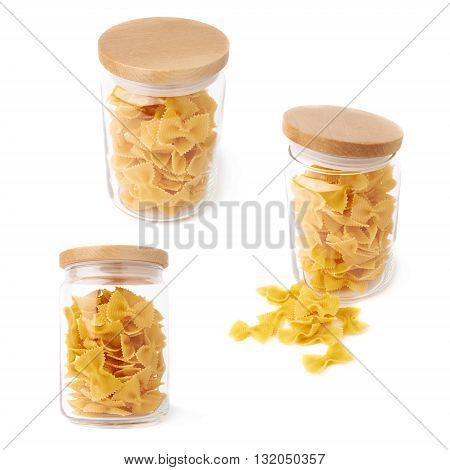 Set of glass jar filled with dry farfalle yellow pasta over isolated white background