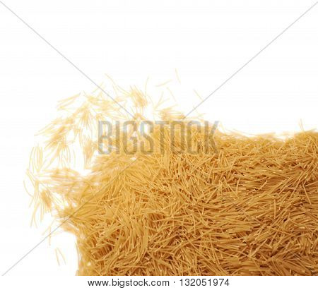 Pile of dry noodles yellow pasta over isolated white background