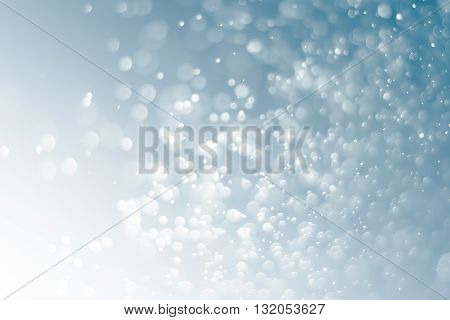 Abstract Black and White Bokeh Lights on gray background.