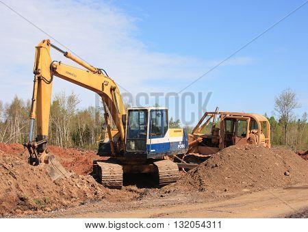 KENNETCOOK CANADA - MAY 29 2016: Komatsu excavator and Dresser bulldozer at rural construction site.