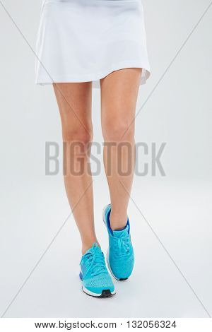 Closeup portrait of a sexy female legs in skirt isolated on a white background