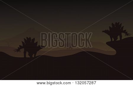 At night Stegosaurus in hills scnery silhouette a very beautiful