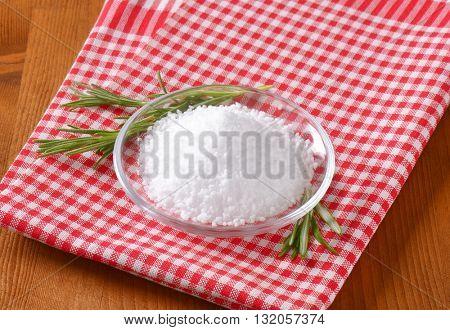 bowl of coarse grained salt on checkered dishtowel