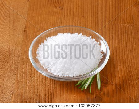 bowl of coarse grained salt on wooden table