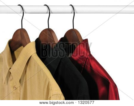 Colorful Shirts On Hangers, On White Background