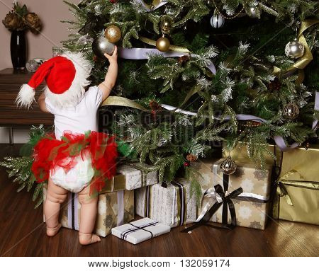 Little girl decorating a Christmas tree toys, holiday, gift, dec