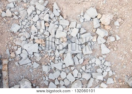 Pieces of beaten bricks on the ground