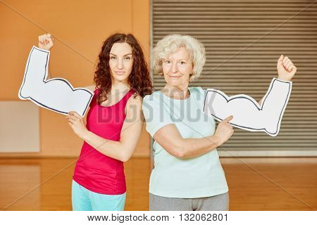 Woman and active senior with muscles at fitness center