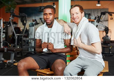 Friends taking a break during workout at the gym