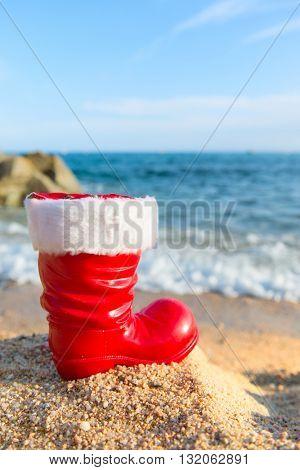 Funny boot of Santa Claus at the beach