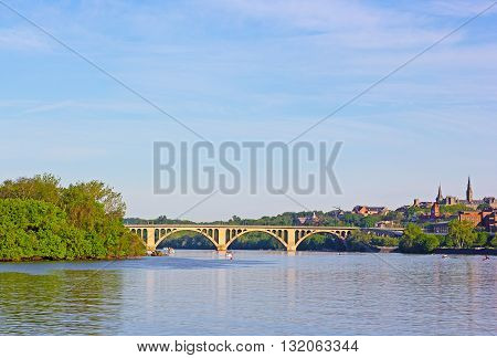 A view on Key Bridge and Potomac River Washington DC USA. Recreational water activities on the river in an early morning.