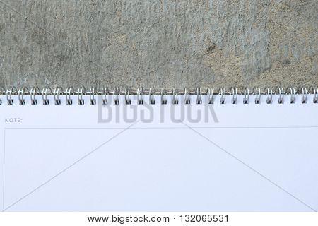 spiral ring bound white calander on stone background