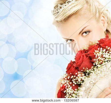Beautiful bride hiding behind luxury bouquet of roses