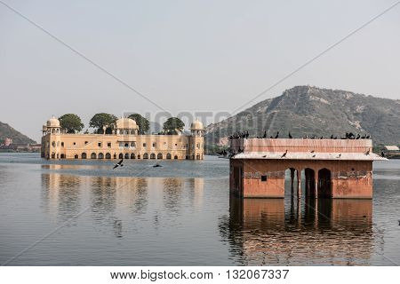 Jal Mahal on the Man Sagar lake in Jaipur, Rajasthan. Built infusing Mughal and Rajput architecture, this palace looks stunning with Aravalli hills on the background.