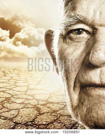 Elderly man's face over dry desert land background