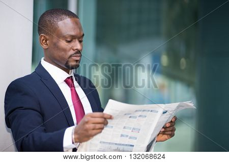 Portrait of a businessman reading a newspaper