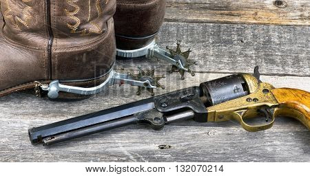 Old western pistol, spurs and cowboy boots.