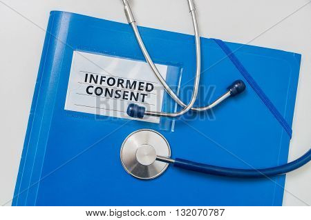 Blue folder with Informed Consent documents. Medicine concept.