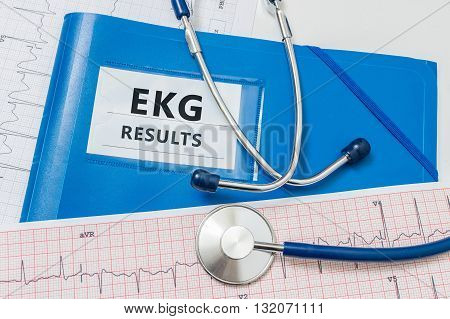 Blue folder with EKG / ECG results and stethoscope.