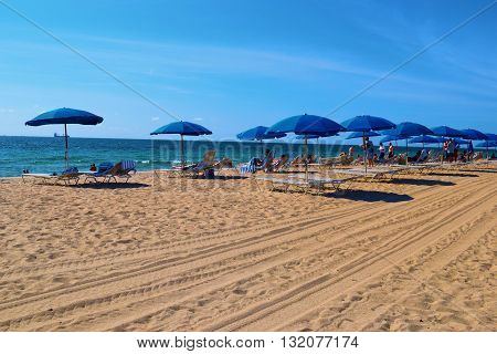 May 20, 2016 in Ft Lauderdale, FL:  Tourists relaxing and sunbathing on lounge chairs under umbrellas on the Ft Lauderdale beach where locals and tourists enjoy leisure and recreation taken in Ft Lauderdale, FL