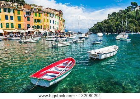 Beautiful sea coast with boats and colorful houses in Portofino Italy