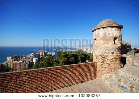 MALAGA, SPAIN - JULY 11, 2008 - Gibralfaro castle watch tower with views over the city and port Malaga Malaga Province Andalucia Spain Western Europe, July 11, 2008.