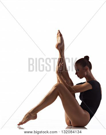 Young woman doing gymnastics exercise over white background