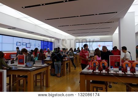 HONOLULU HI - NOVEMBER 27: People look at products inside Microsoft Windows Store in Honolulu at the Ala Moana Center who's technology is in most modern computers on November 27 2014.