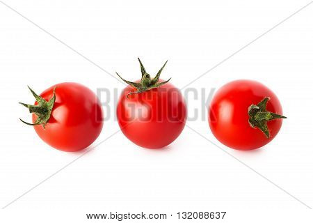 Cherry tomatoes. Three cherry tomatoes isolated on white background