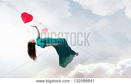 Woman floating in sky