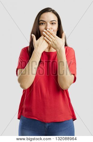 Lovey woman covering her mouth with hands