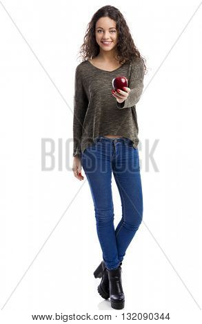 Portrait of a beautiful woman holding a fresh red apple, isolated in white background