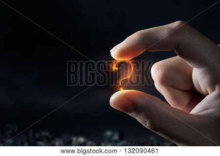 Question mark holden with fingers