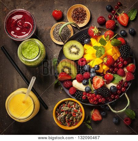 fresh summer fruits and berries on plate, above, rustic background