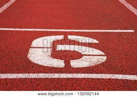 Number Six. White Athletic Track Number On Red Rubber Racetrack, Texture Of Racetracks In Stadium