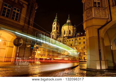 blurred movement on the night street tram in Prague