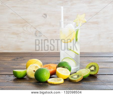 Ice cold drinks and exotic fruits on wooden background