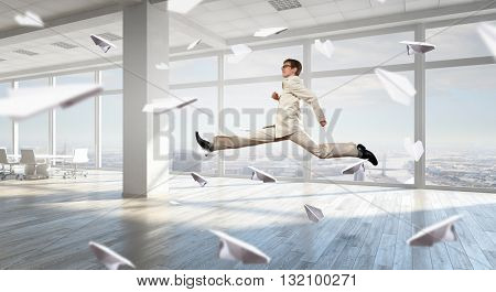 Dancing businessman in office