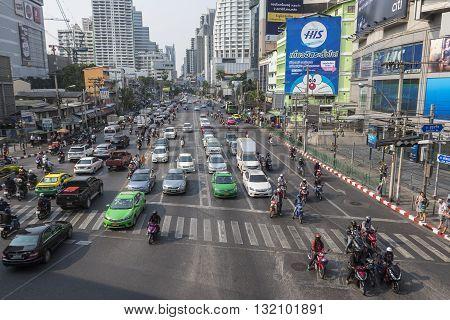 BANGKOK THAILAND - APR 29 : masstive of traffic at Asoke junction on Ratchadapisek road on april 29 2016 thailand. traffic jam is one of worse issue of Bangkok