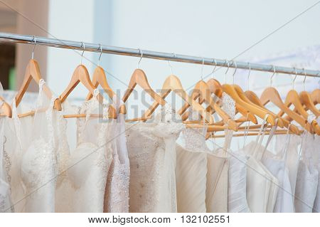 White Wedding dresses on trempel in shop.