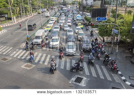 BANGKOK THAILAND - APR 29 : car stop on red light signal on Ratchadapisek Road in Asoke junction on april 29 2016 thailand. traffic jam is one of worse issue of Bangkok