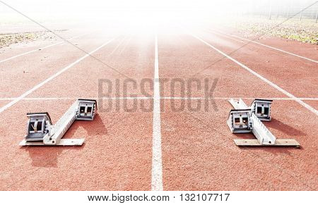 starting blocks on running tracks sport concept